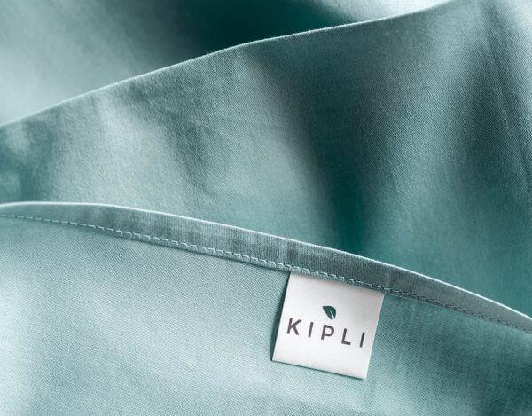Housse couette coton bio couleur bleu pastel avec étiquette Kipli